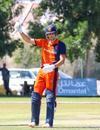 Ben Cooper raises his bat to acknowledge his half-century, Oman v Netherlands, Oman Quadrangular T20I Series, Al Amerat, February 15, 2019