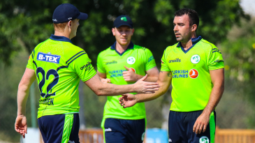 Stuart Thompson gets congratulated after taking another wicket