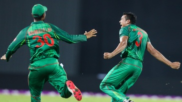 Taskin Ahmed and Mahmudullah celebrate a wicket