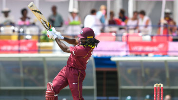 Chris Gayle drills another six in his boundary-laden century