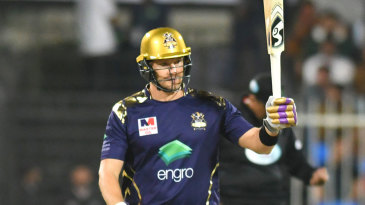 Shane Watson raises his bat after getting his fifty