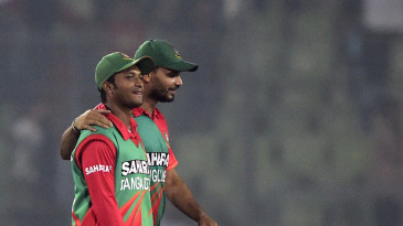 Shakib Al Hasan and Mashrafe Mortaza walk off the field after the win