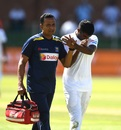 Lasith Embuldeniya is helped off the field after injuring his left thumb, South Africa v Sri Lanka, 2nd Test, Port Elizabeth, 1st day, February 21, 2019
