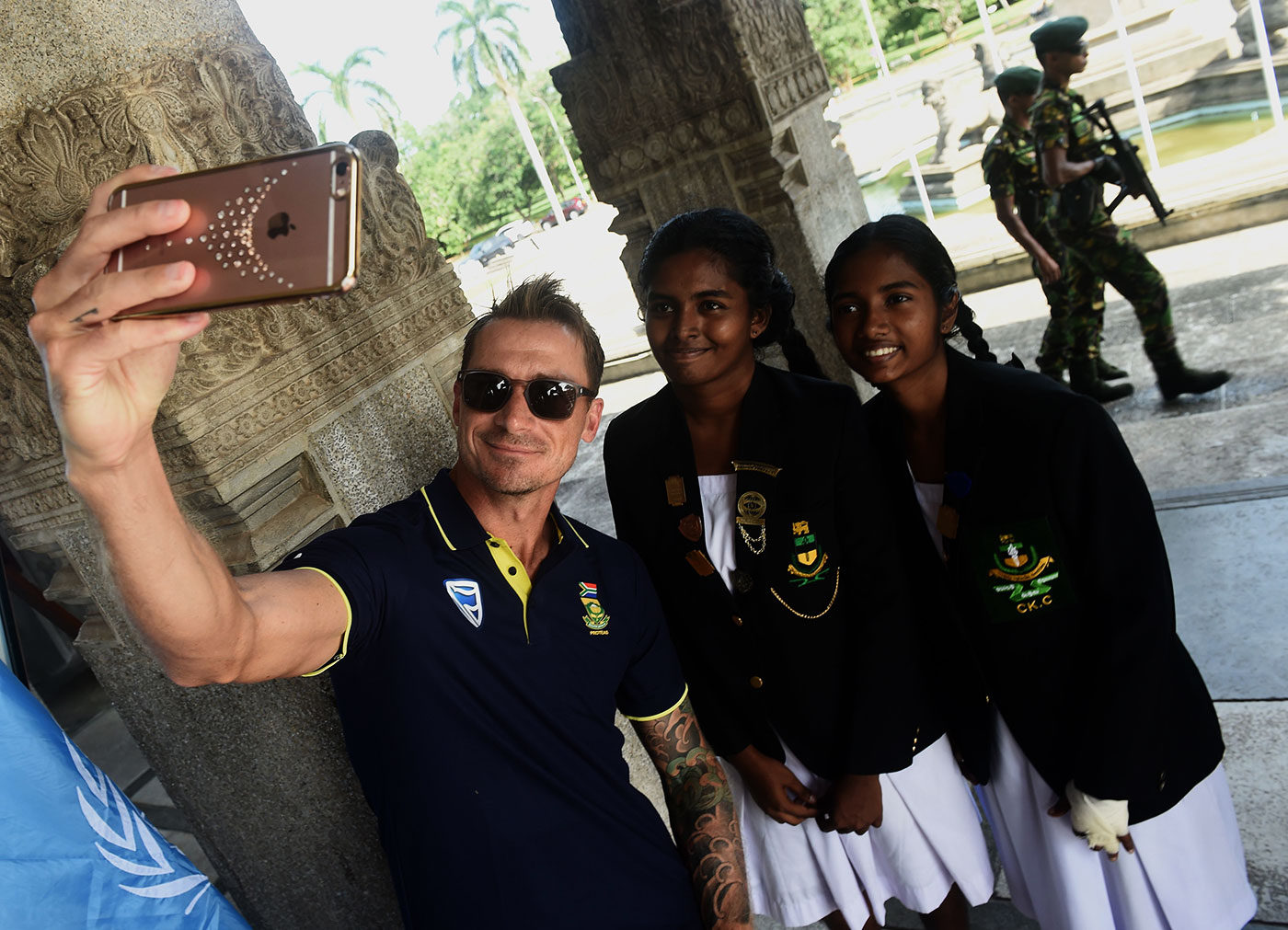 Steyn takes a selfie with two schoolgirls at a ceremony in Colombo to mark Nelson Mandela's birth centenary