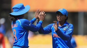 Ekta Bisht celebrates a wicket with captain Mithali Raj