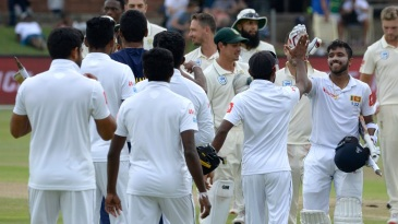 The Sri Lankans celebrate their eight-wicket win in Port Elizabeth