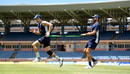 Chris Woakes warms up with Liam Plunkett during a nets session at the National Cricket Stadium, Grenada, February 24, 2019