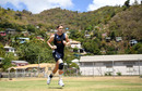 Chris Woakes runs in to bowl during a nets session at the National Cricket Stadium, Grenada, February 24, 2019