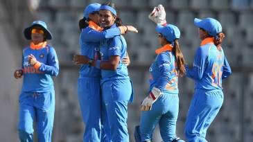 Fast bowler Shikha Pandey celebrates a wicket with her team-mates
