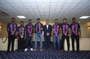 Members of Sri Lanka's squad that won the Test series in South Africa pose with Minister of Sports Harin Fernando