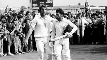 Ian Botham commiserates with Allan Border, who made an unbeaten century in the second innings