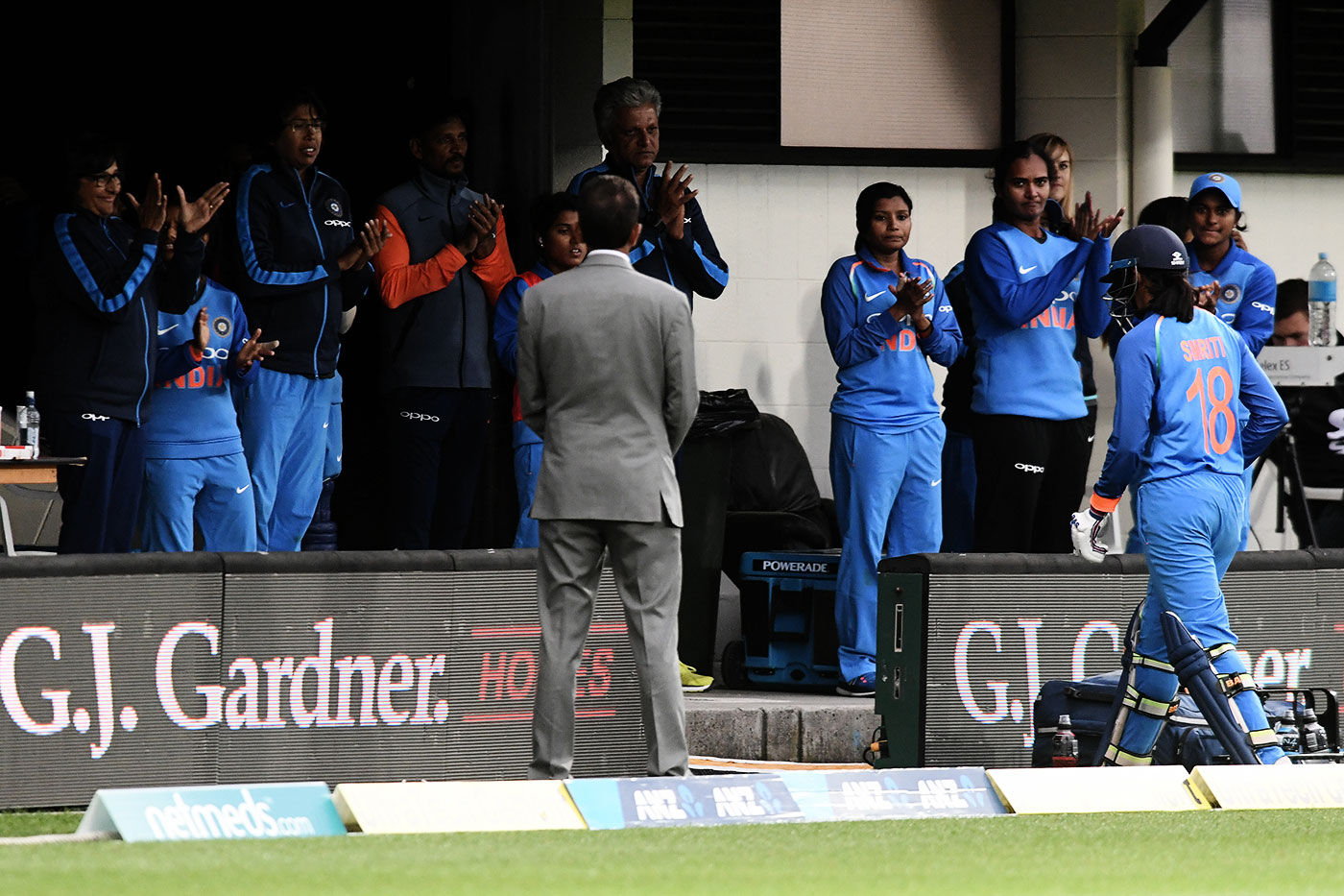 Mandhana's team-mates cheer after she comes back having made a century in the Napier ODI earlier this year