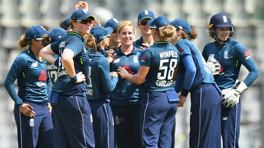 Katherine Brunt celebrates with her team-mates after a wicket