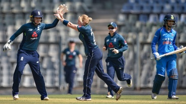 Katherine Brunt celebrates Smriti Mandhana's wicket