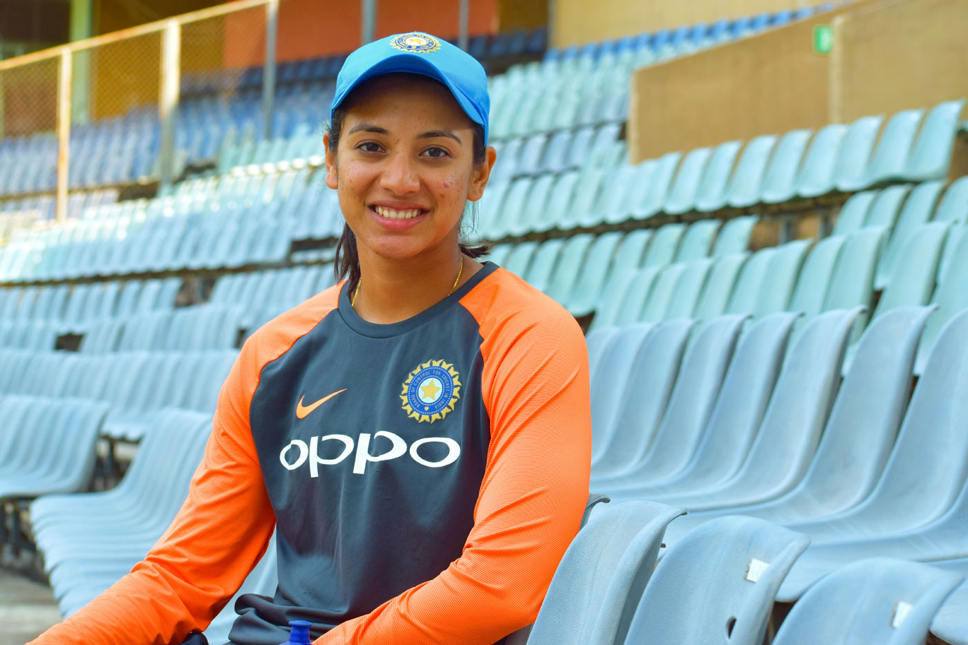 Smriti Mandhana sits in a stand at the Wankhede Stadium