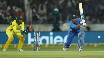 MS Dhoni forces one through the off side