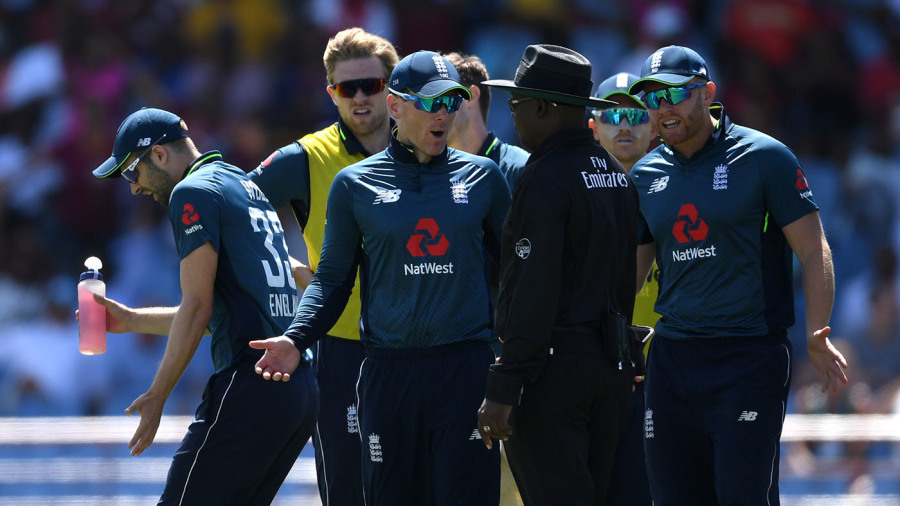 Eoin Morgan and his players react to a no-ball call by the third umpire