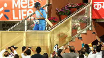 MS Dhoni walks out to bat at his home ground
