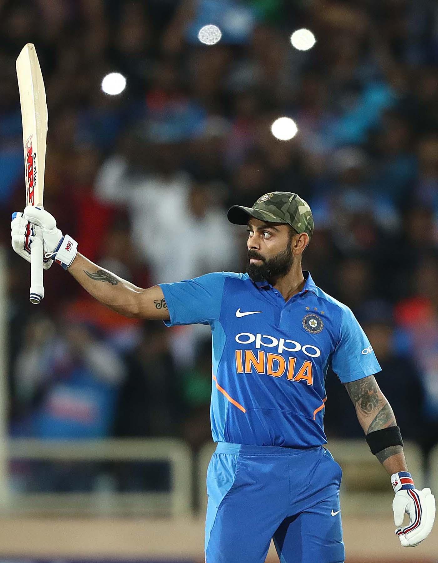 Virat Kohli Raises His Bat After Getting To His 41st Odi