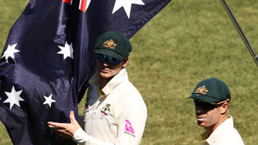 Steven Smith and David Warner look on