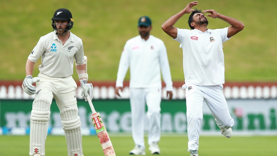 Abu Jayed reacts to a dropped catch as Kane Williamson looks on
