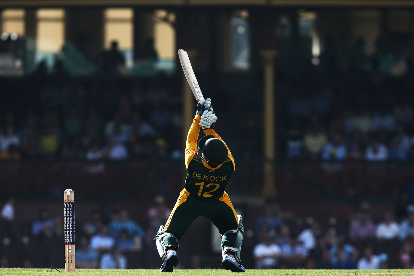 Quinton de Kock bends over backwards to play a shot