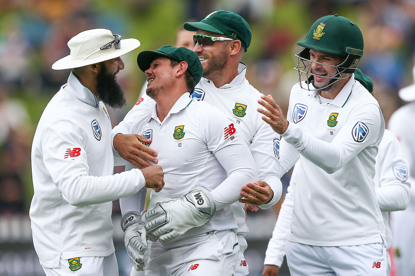 De Kock gets some love from his team-mates: (from left) Hashim Amla, Faf du Plessis and Stephen Cook