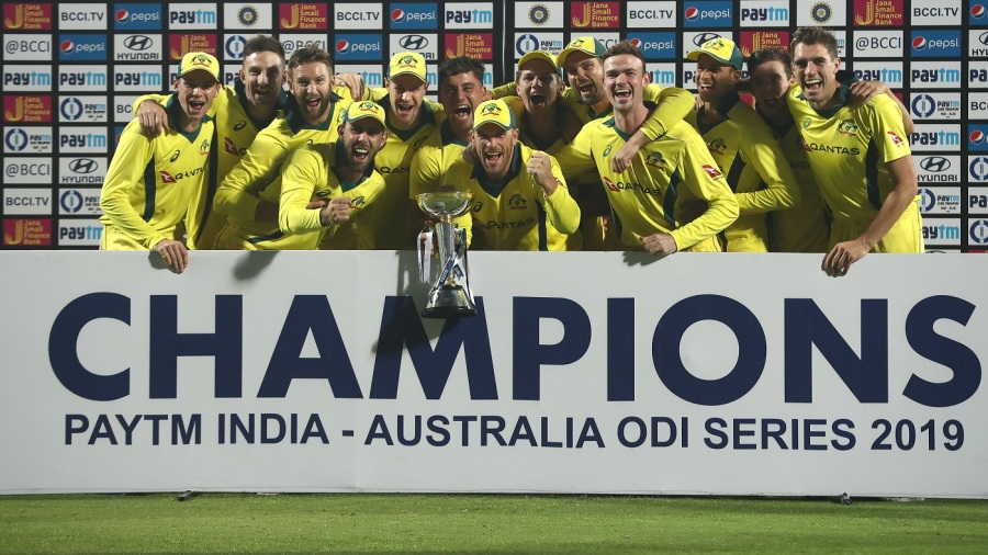 The victorious Australian team poses with the trophy after winning the series