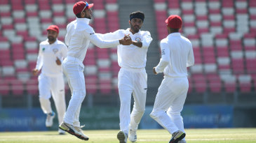 Yamin Ahmadzai celebrates after getting a wicket