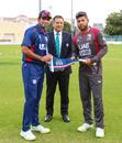 USA captain Saurabh Netravalkar presents a Team USA flag at the toss for USA's maiden T20I, UAE v USA, 1st T20I, Dubai, March 15, 2019