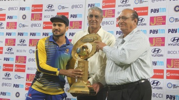 Karnataka captain Manish Pandey receives the Syed Mushtaq Ali Trophy
