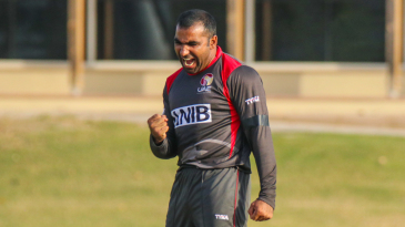 Sultan Ahmed pumps his fist after taking a big wicket