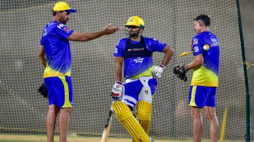 Suresh Raina gets some pointers from Stephen Fleming and Mike Hussey