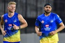 Sam Billings and Harbhajan Singh warm up ahead of a Chennai Super Kings training session