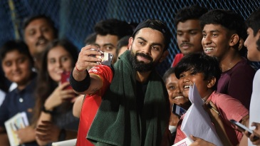 Virat Kohli with his fans during an RCB training session in Chennai ahead of the IPL 2019 opener