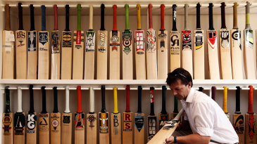 Oliver Wright, a Director at JS Wright & Sons, examines some of the finished cricket bats made by the companies he supplies with willow clefts