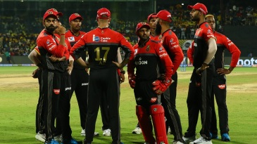 A pensive RCB side wait to take the field