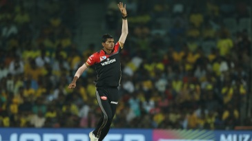 Navdeep Saini reacts after bowling