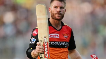 David Warner raises his bat to acknowledge the applause
