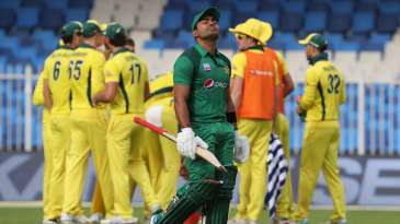 A frustrated Umar Akmal leaves the field