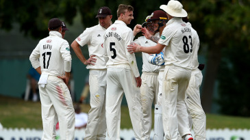 Freddie Van Den Bergh of Surrey celebrates taking the wicket of Dan Lawrence of MCC