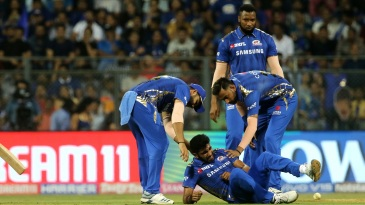 Jasprit Bumrah took a tumble and appeared to hurt his left shoulder
