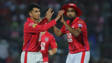 Mujeeb Ur Rahman and R Ashwin celebrate a wicket