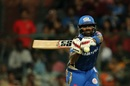 Suryakumar Yadav reaches out to hit the ball, Royal Challengers Bangalore v Mumbai Indians, IPL 2019, Bengaluru, March 28, 2019