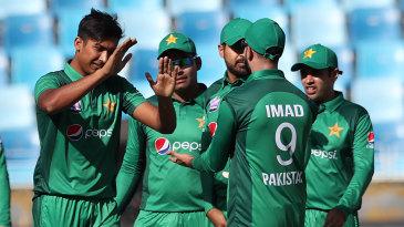 Mohammad Hasnain rejoices a wicket