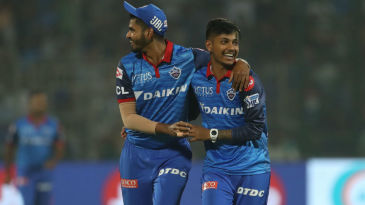 Sandeep Lamichhane celebrates with Shreyas Iyer