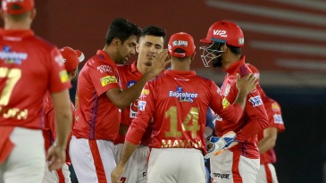 R Ashwin celebrates a wicket with his team-mates