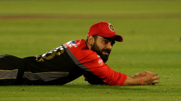 Virat Kohli watches the ball dribble away after dropping a catch