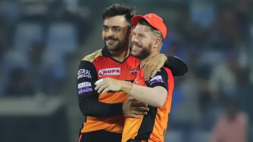 Rashid Khan and David Warner share a light moment