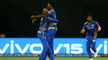 Alzarri Joseph gets a hug from Krunal Pandya after taking a wicket